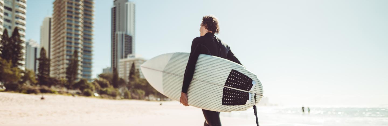 Surfer Walking In Surfers Paradise Beach In Australia