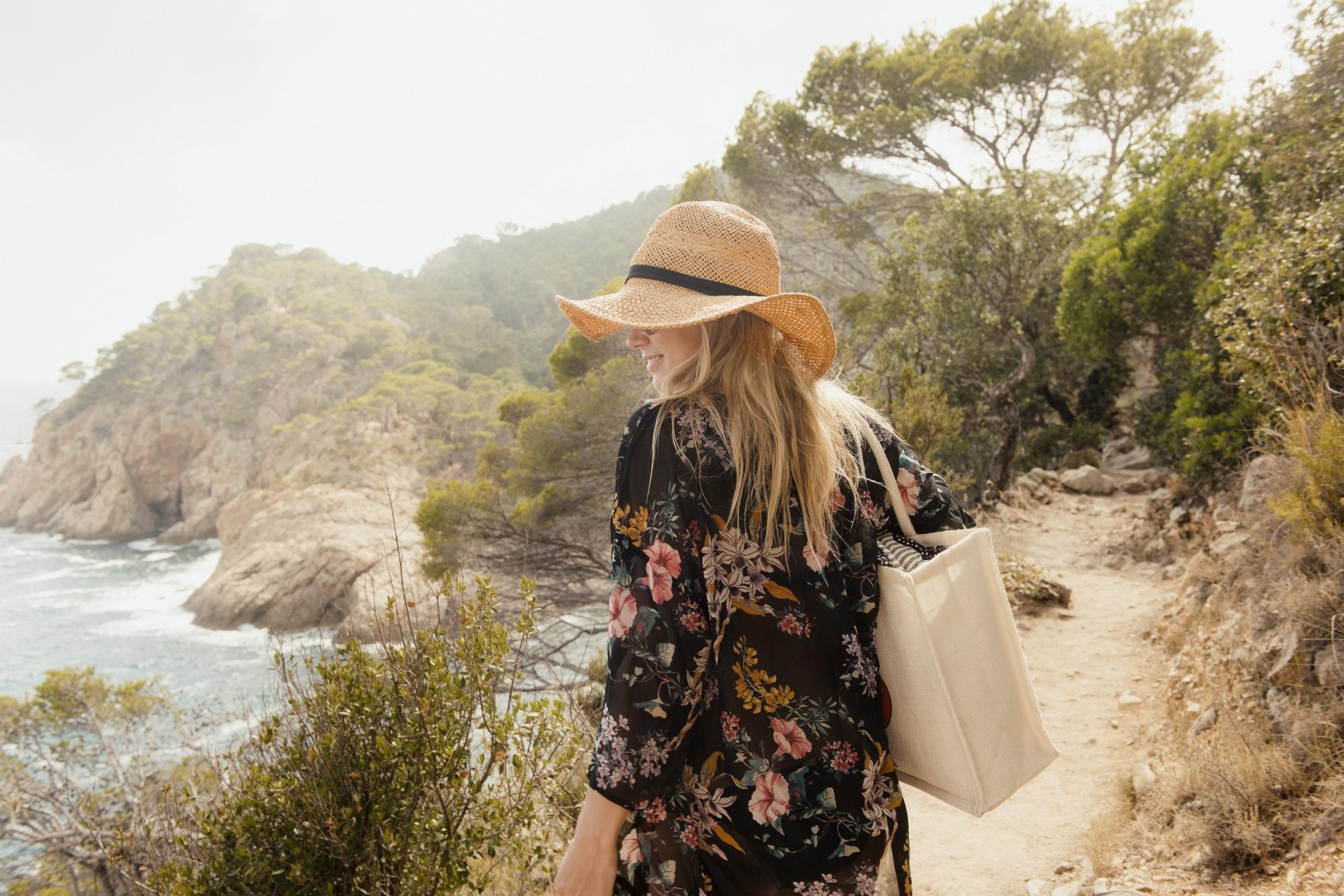 Woman Walking Along Coastal Pathway, Rear View, Tossa De Mar, Catalonia, Spain